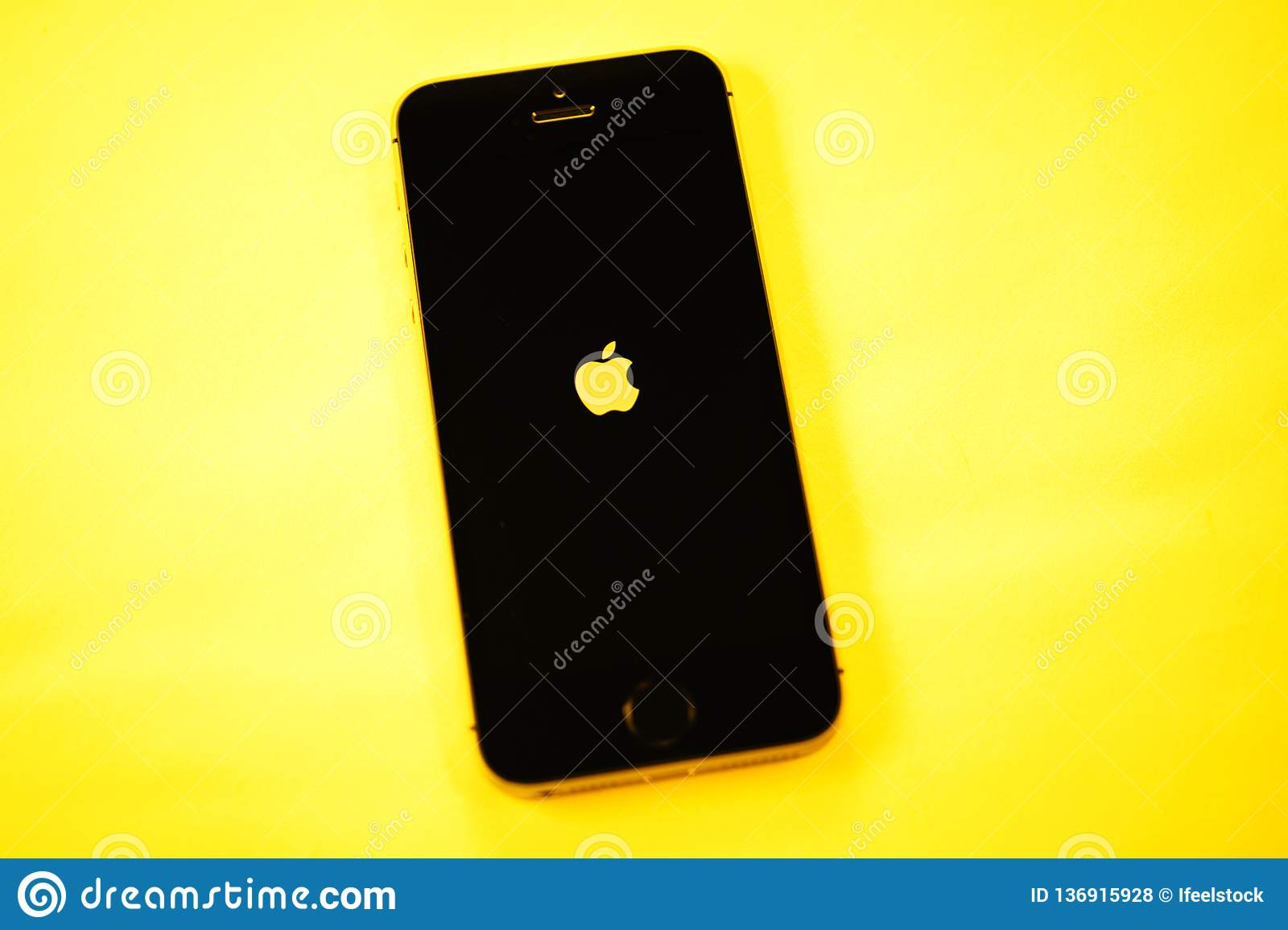 Newest Apple Computers IPhone SE On Yellow Background