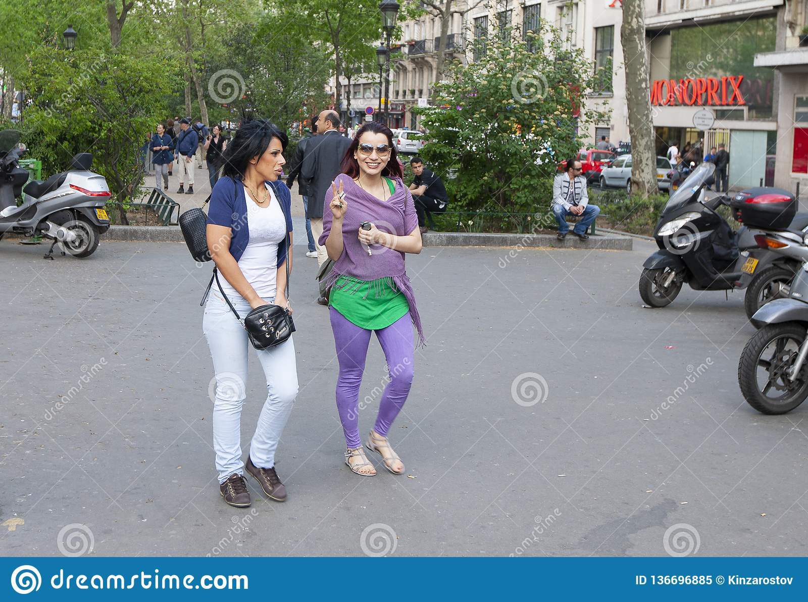 Paris, France - April 11, 2011: Two happy women are having fun together in the city