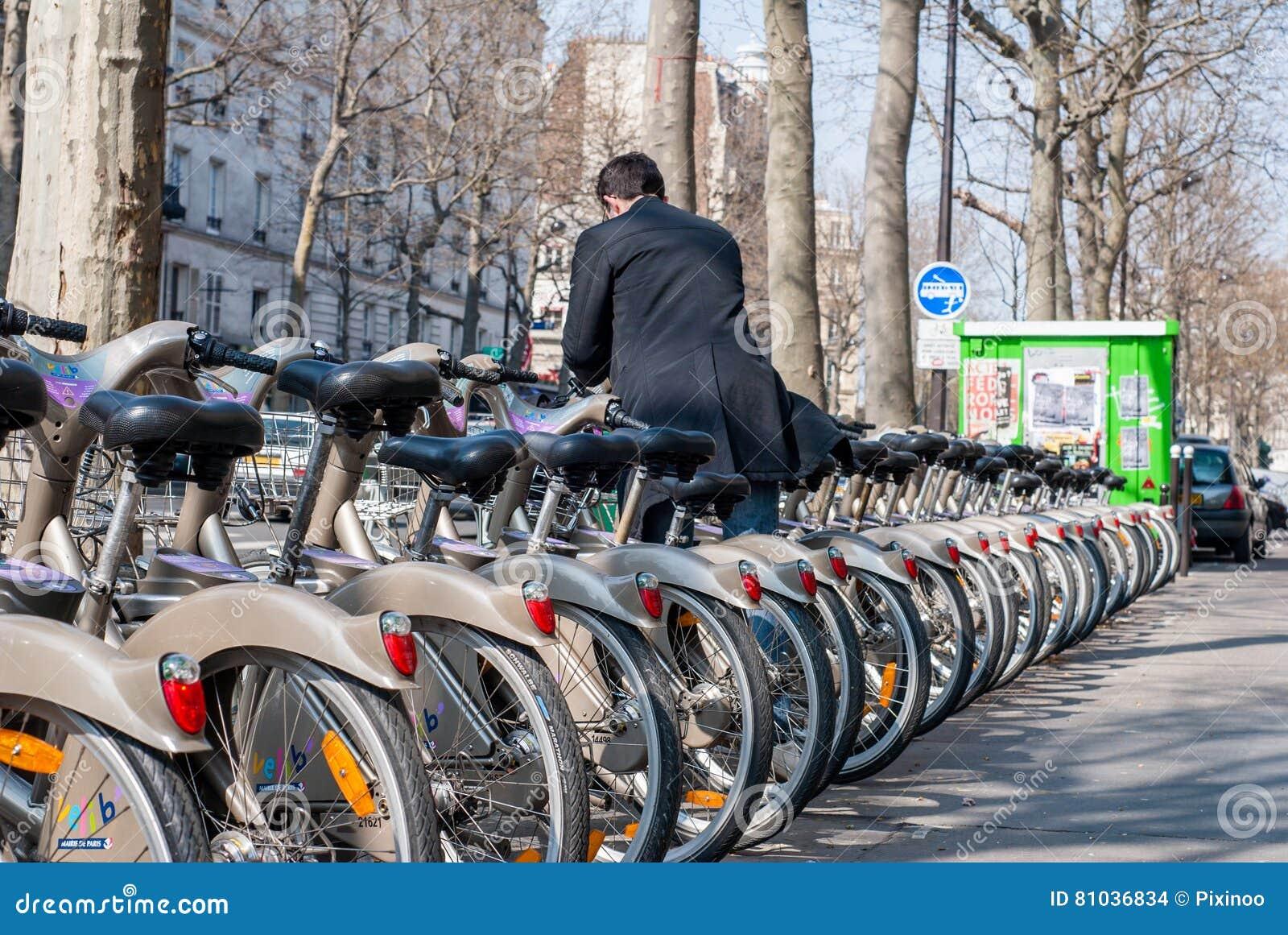 Paris, France - April 02, 2009: Young man depositing his bike at