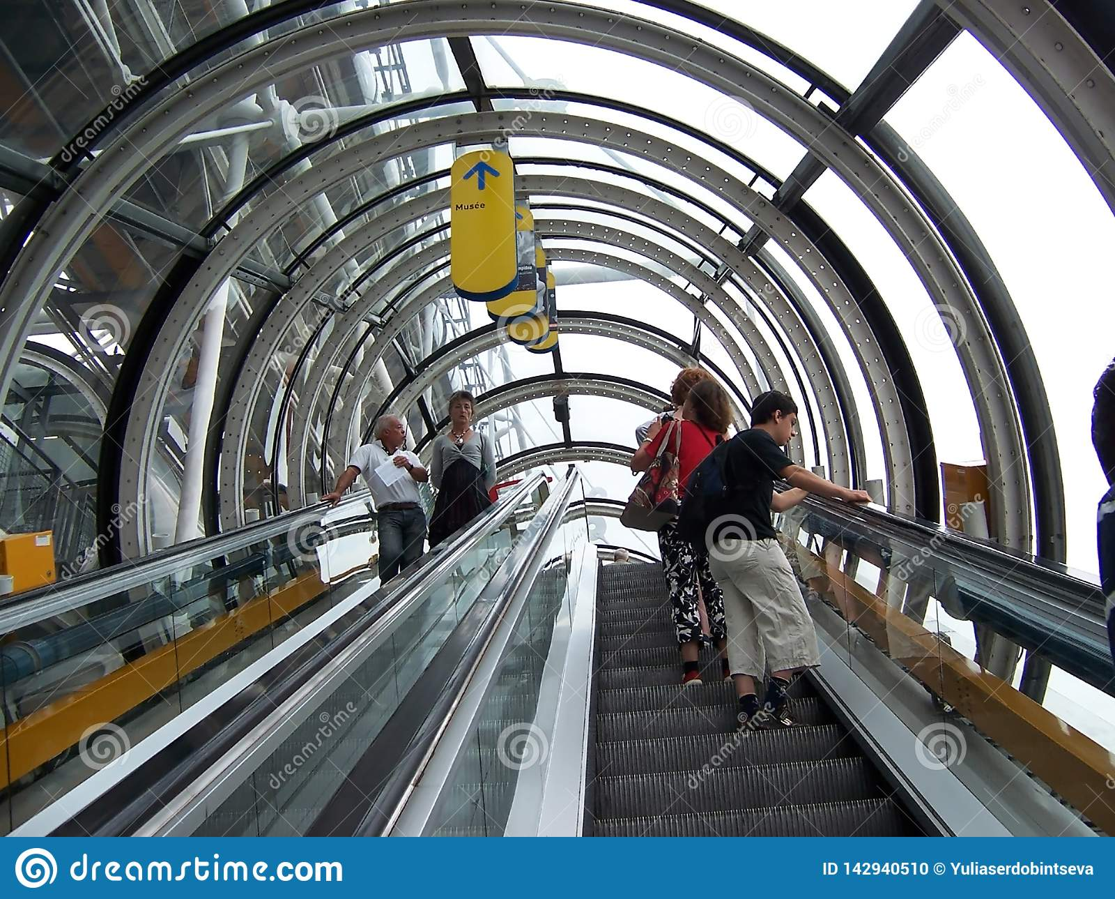 Paris, France-August 07, 2009: People go on the escalator at the Pompidou Museum