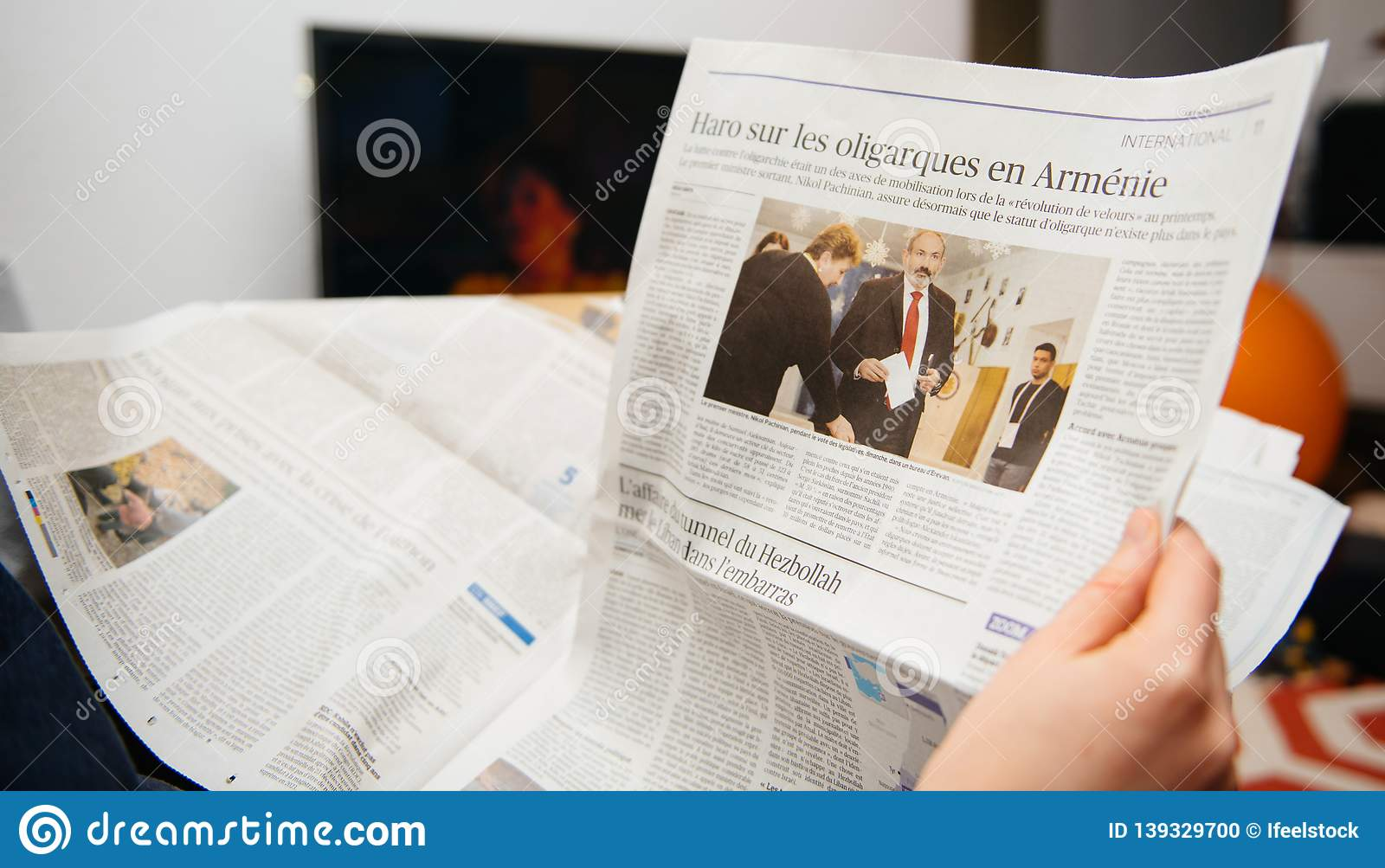 Woman reading french le figaro newspaper armenian oligarchs