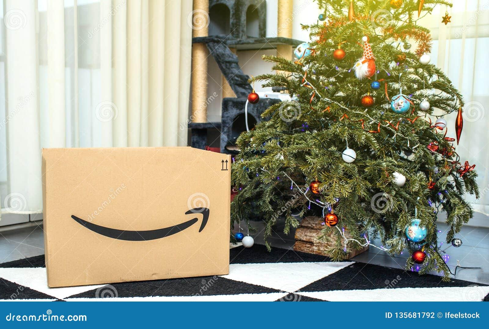 Amazon Cardboard Box Near Christmas Tree In The Living Room
