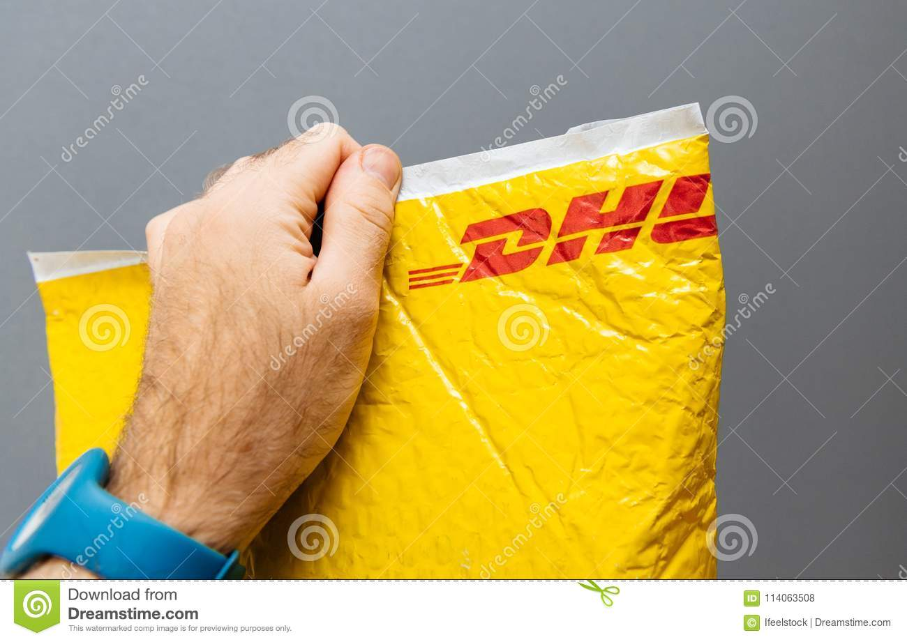 DHL Express Yellow Parcel Plastic Pouch Editorial Stock