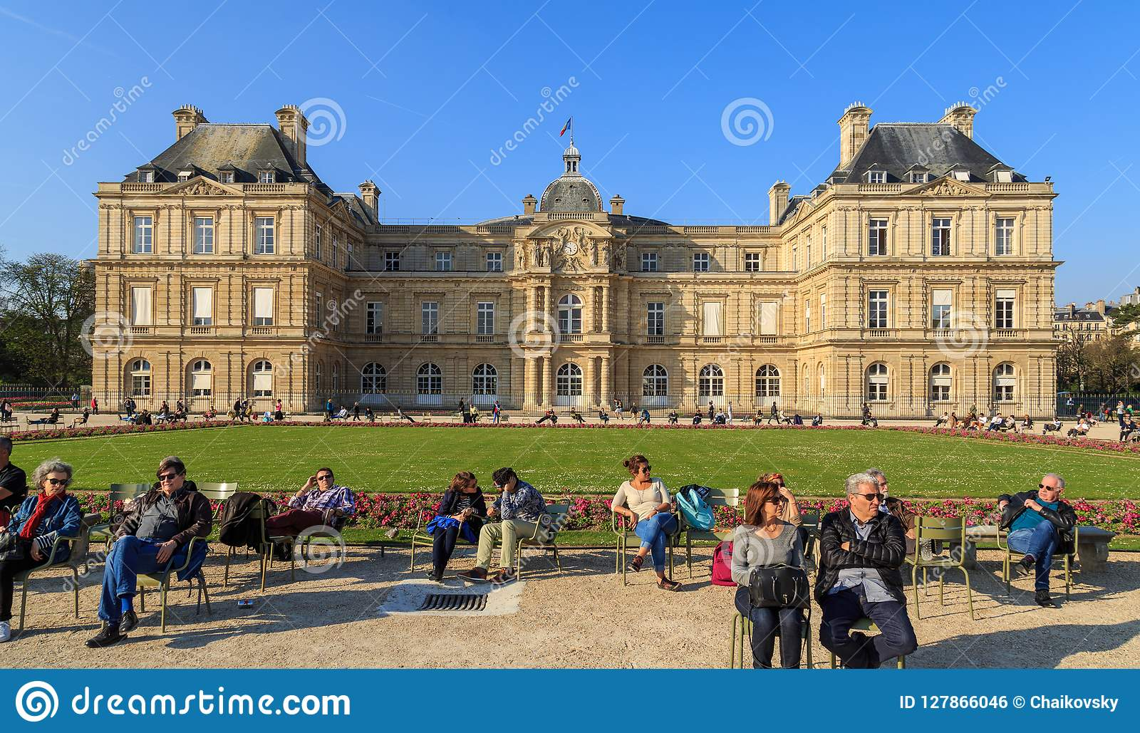 Paris, France, March 27 2017: People enjoy sunny day in the Luxembourg Garden in Paris. Luxembourg Palace is the