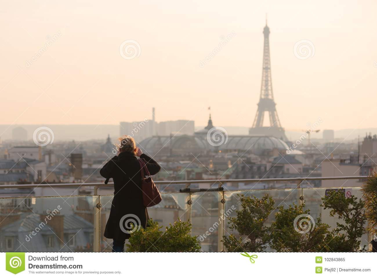 Woman taking the Eiffel tower in photo