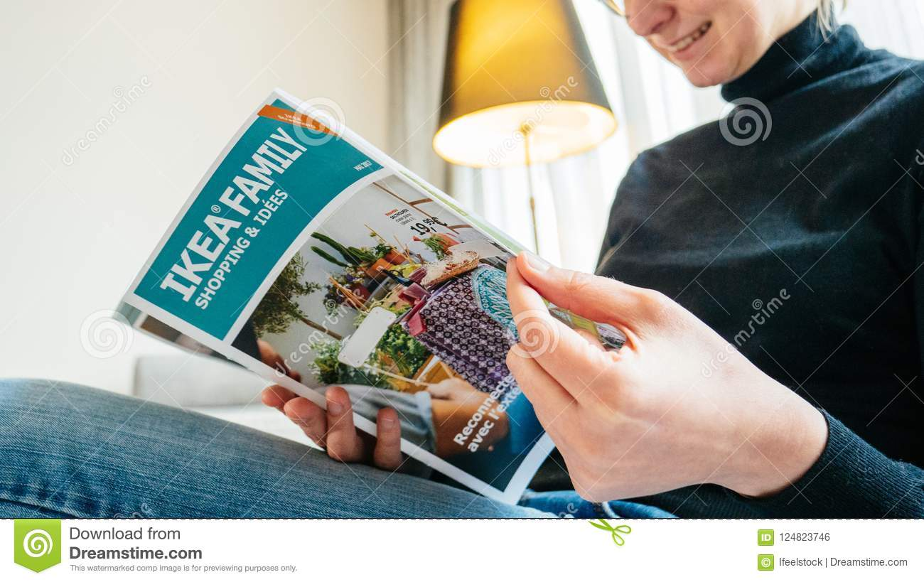 Woman Reading Ikea Catalogue Onthe Living Room Couch Editorial Photo