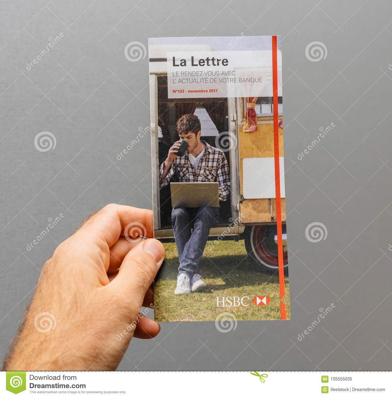 Man Hand Holding Against Gray Background The Official HSBC