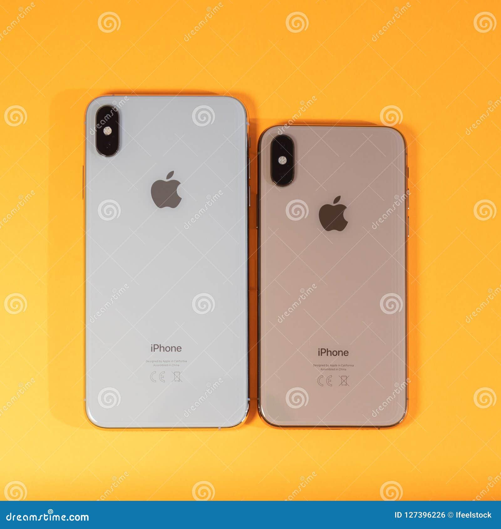 Apple Iphone Xs Max Against Vibrant Orange Background