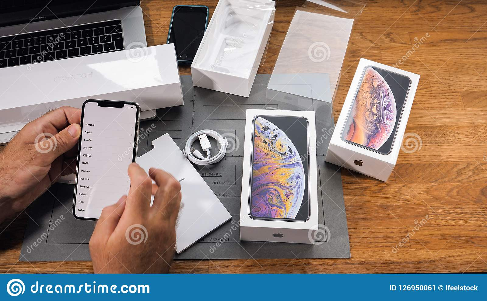 Man Unboxing IPhone Xs Max Xr Select Language On Phone ...