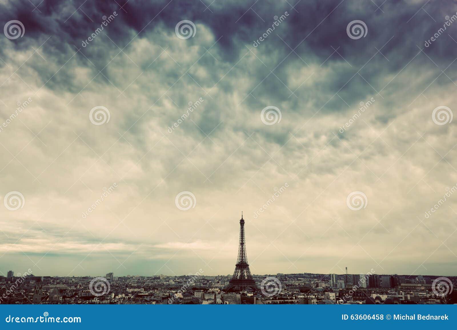 Paris, France skyline with Eiffel Tower. Dark clouds