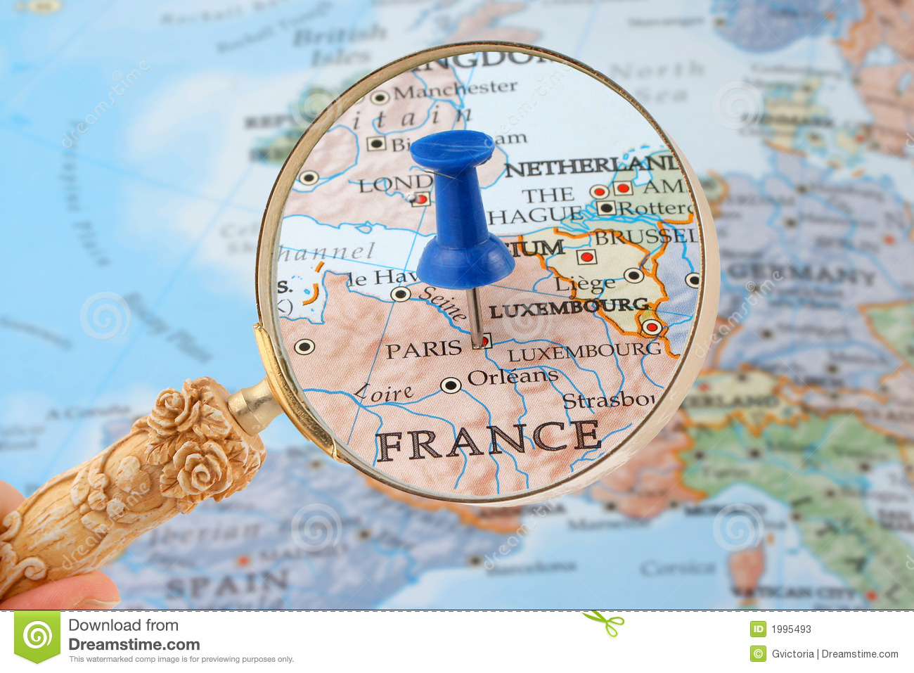 Magnifying glass over Paris, France map with destination tack.