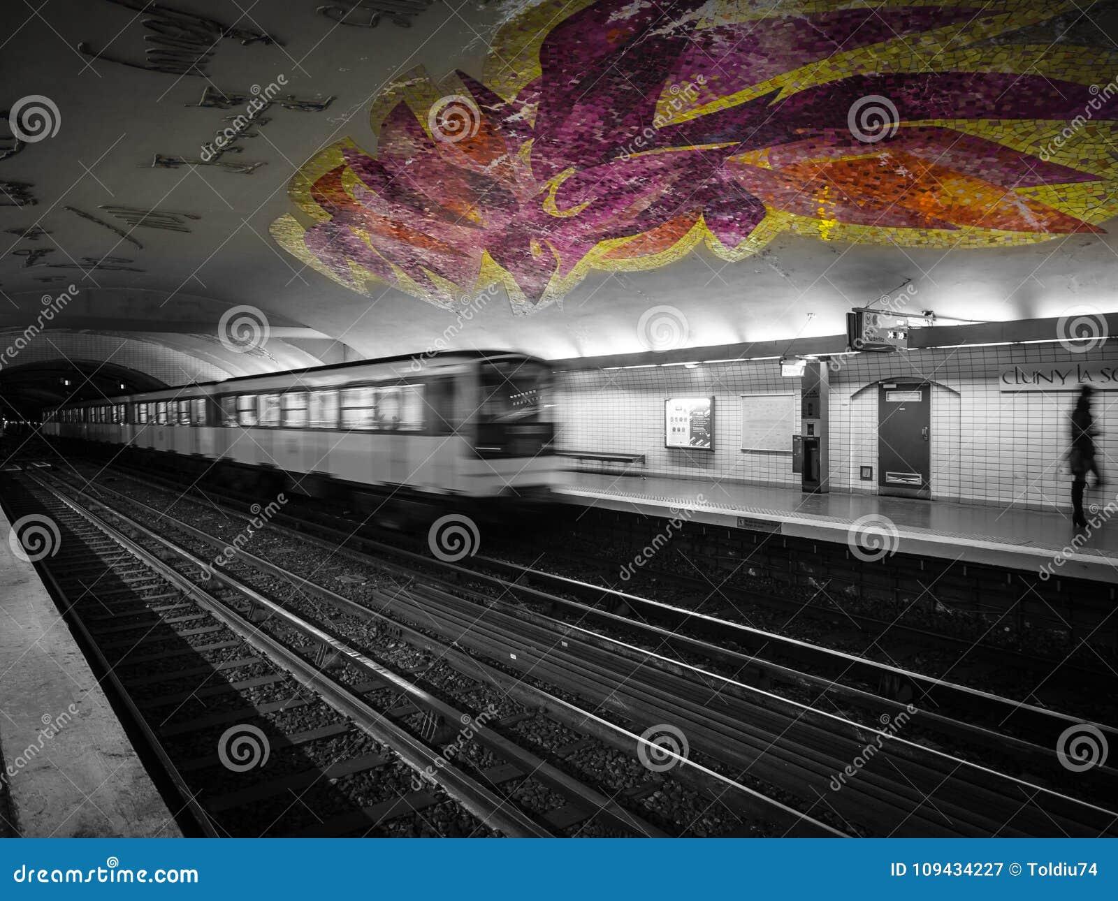 Mosaic ceiling in gaudy colors in the Paris metro.