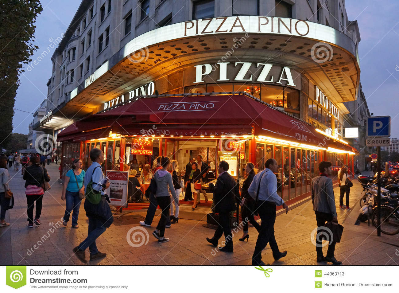 Paris Pizza Restaurant At Night Editorial Stock Photo