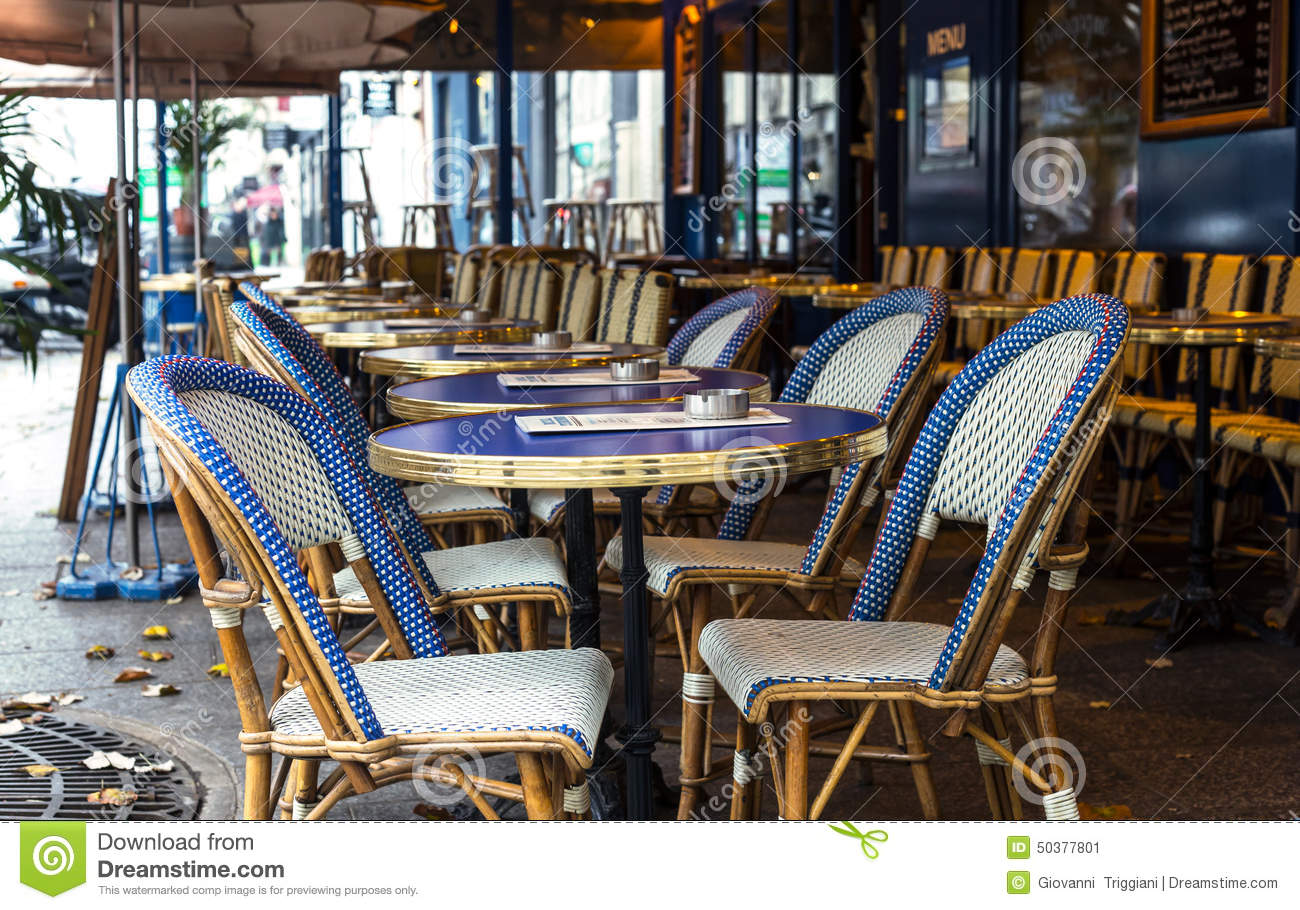 Paris Street View Of A Bistro With Tables And Chairs