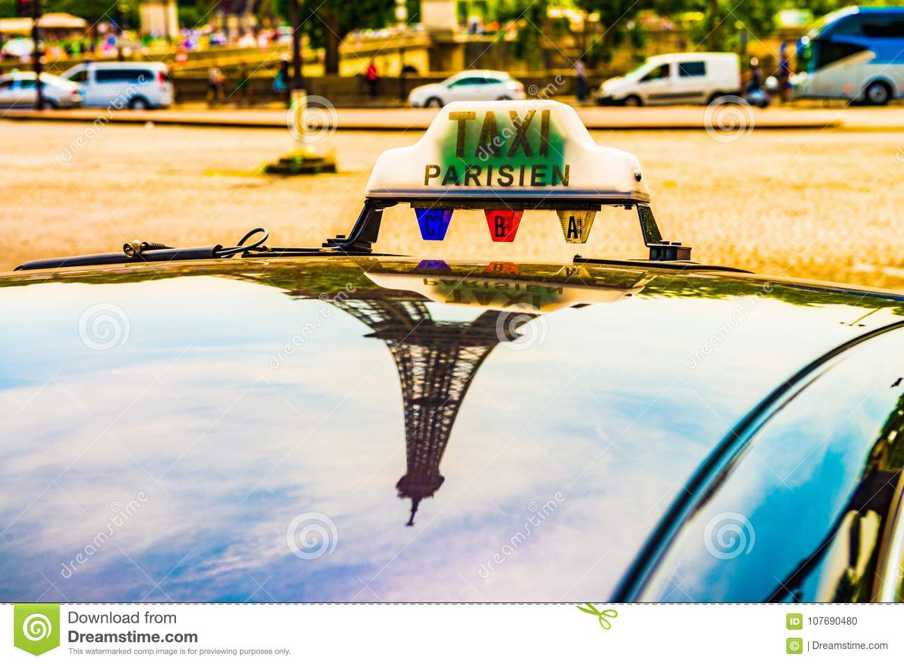 Parisian taxi roof showing the eiffel tower as a reflection.