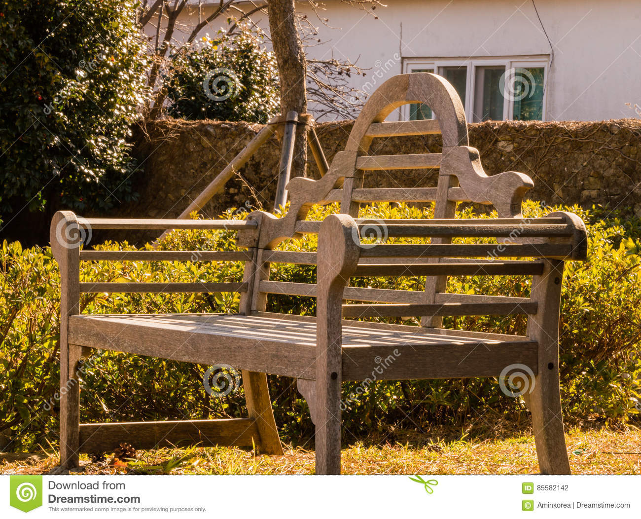 Park Bench In Bathed In Sunlight Stock Photo - Image of ...