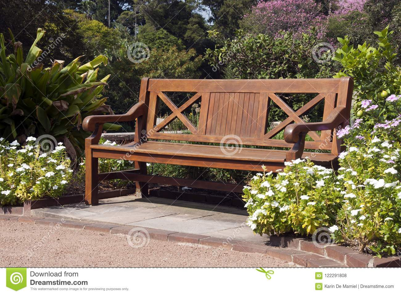 Phenomenal Park Bench Surrounded By Flowering Plants Stock Photo Ibusinesslaw Wood Chair Design Ideas Ibusinesslaworg