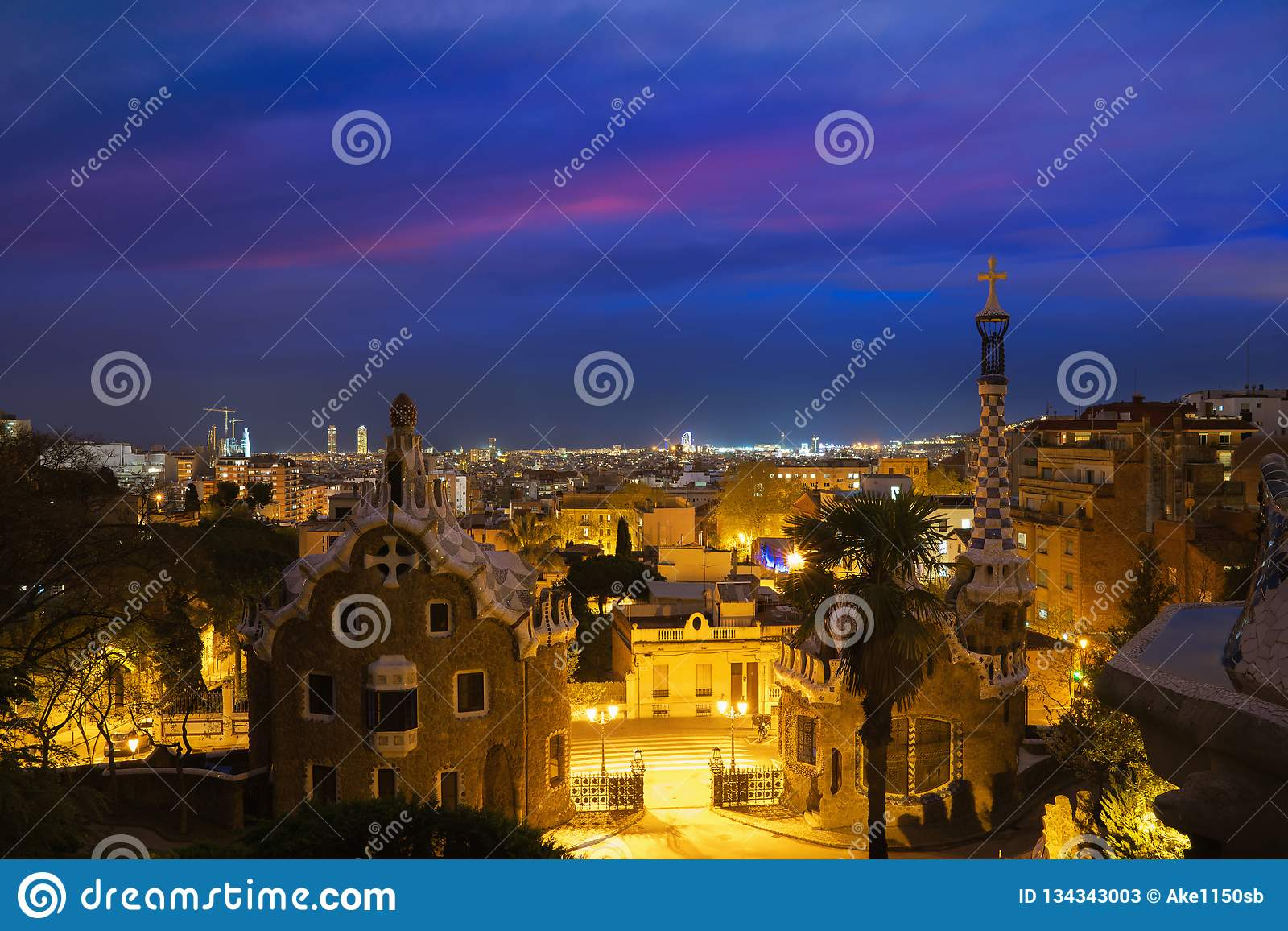 Park Guell in Barcelona, Spain at night. Barcelona skyline