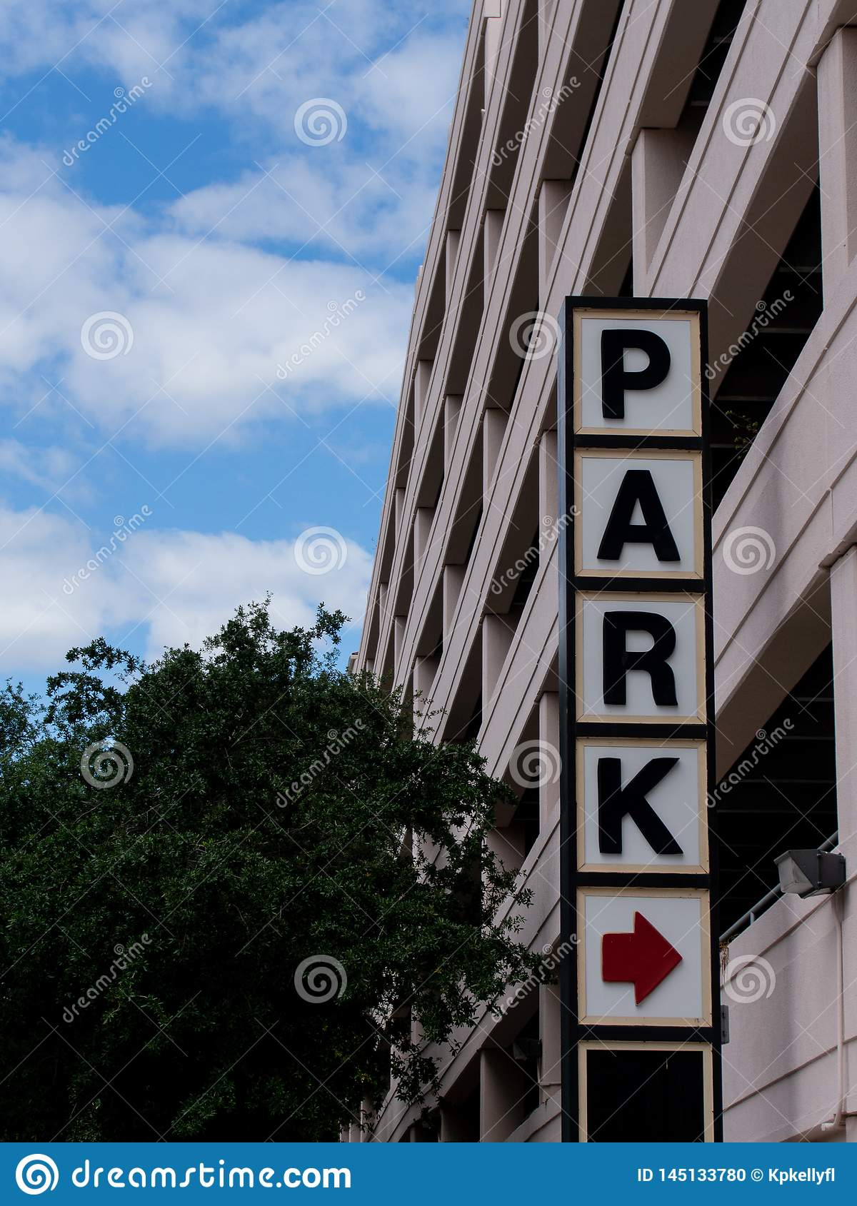 Park sign outside of a parking garage