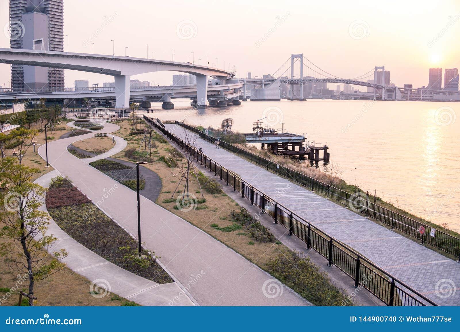 Park on tokyo bay in front of rainbow bridge