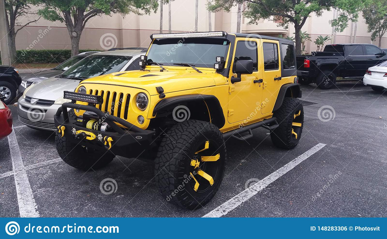 Parking concept. Yellow suv car parked outdoors. Modern vehicle. Transport and transportation concept. Car at paved