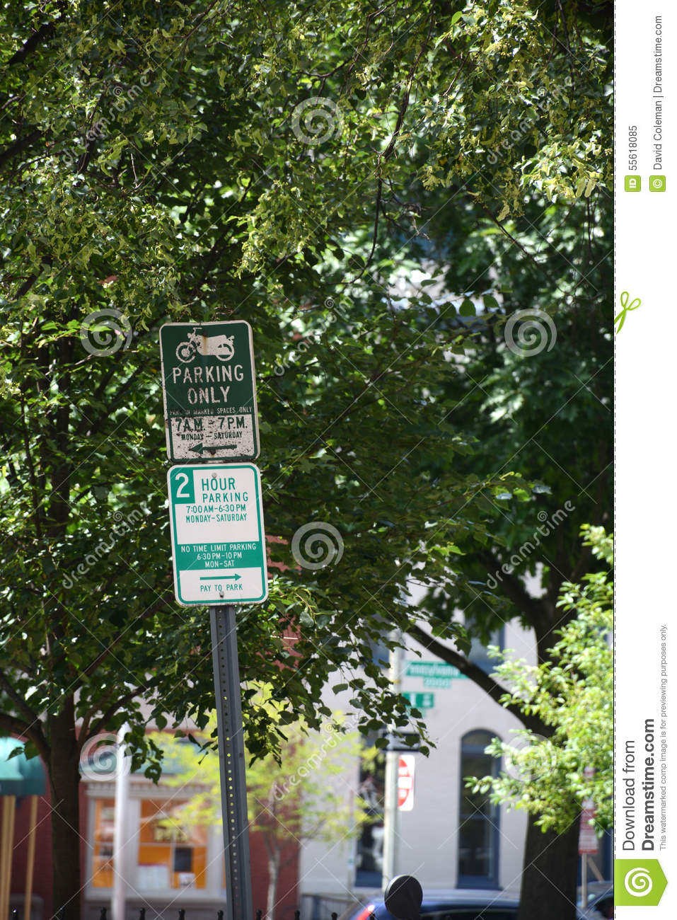 Parking Signs In Washington DC Showing Motorcycle Only And A Two Hour Limit
