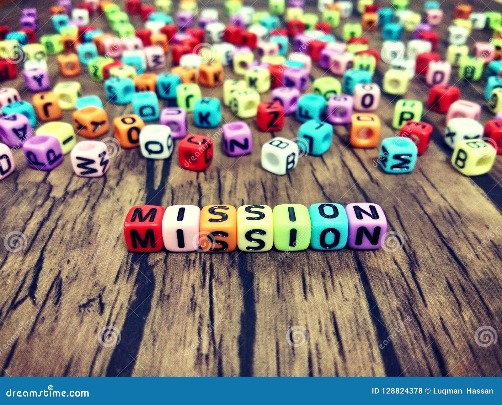 Parola di MISSIONE degli alfabeti colourful del cubo