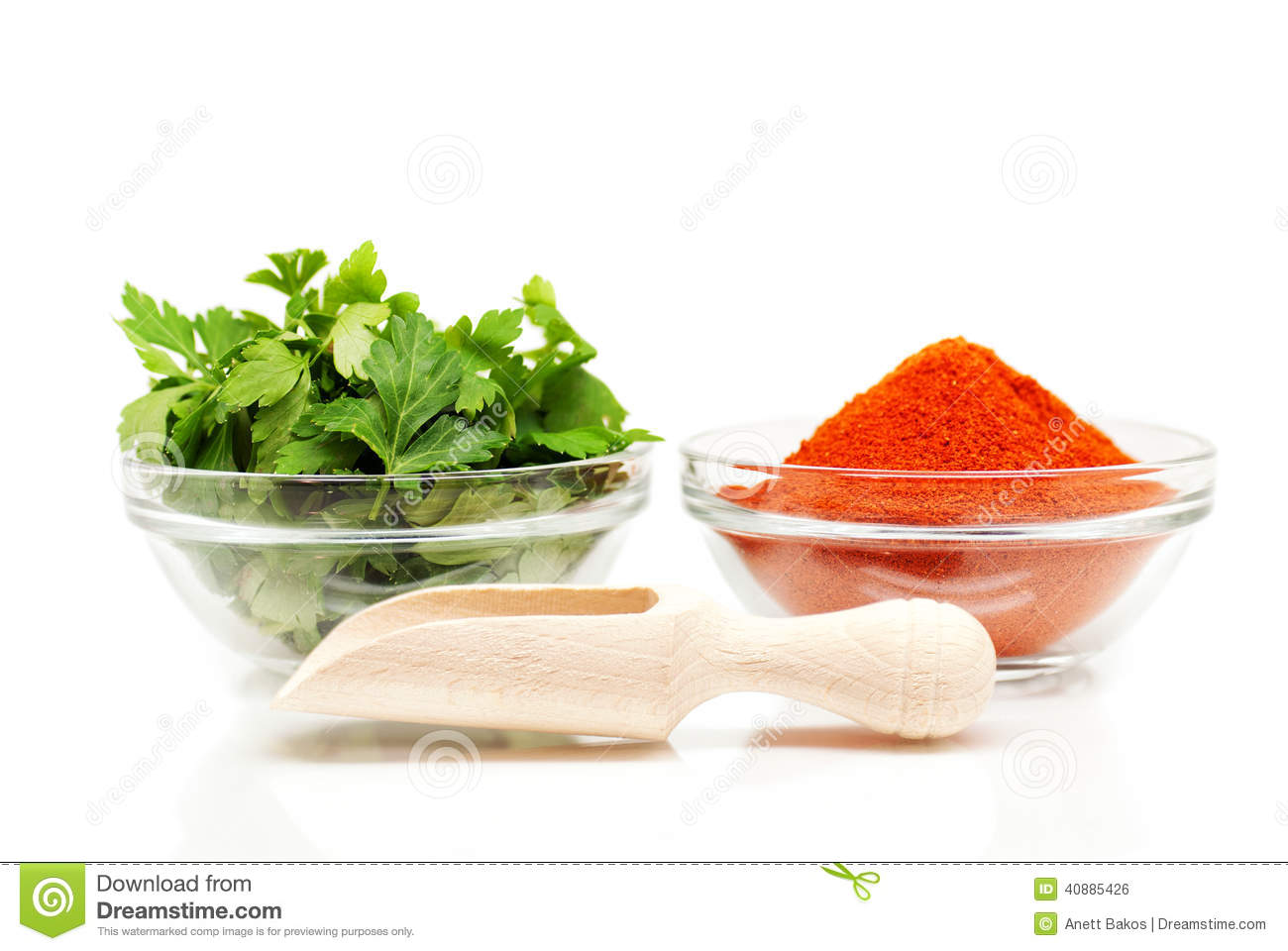 Parsley and red ground pepper and wooden spoon