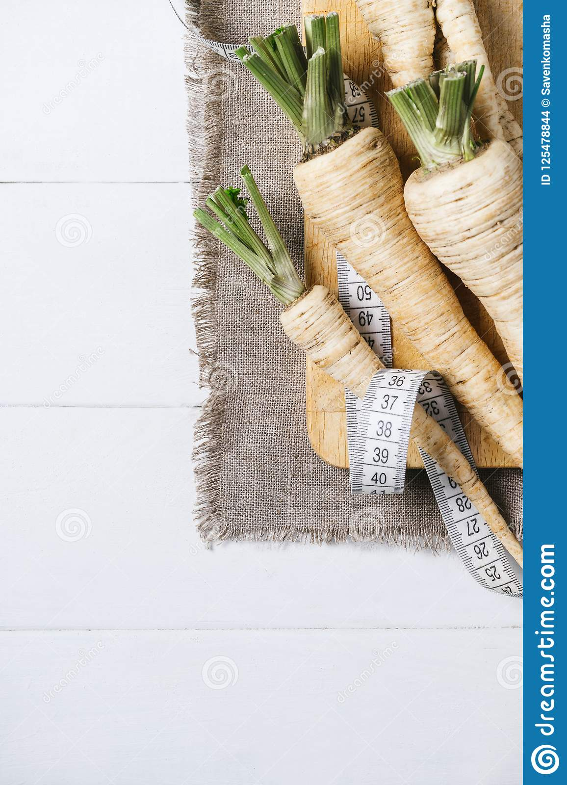 Parsley Root With A Measuring Tape And Tomatoes On Cutting Board On A White Background Of The Old Wooden Boards Vintage Top View V Stock Photo Image Of Display Meter 125478844