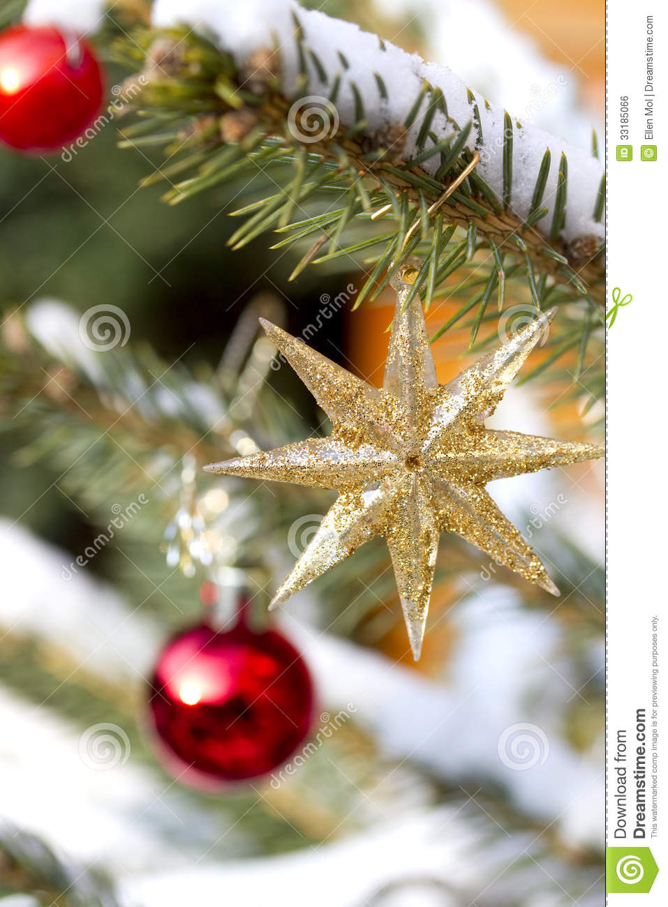 Part of a christmas tree with ornaments stock photo