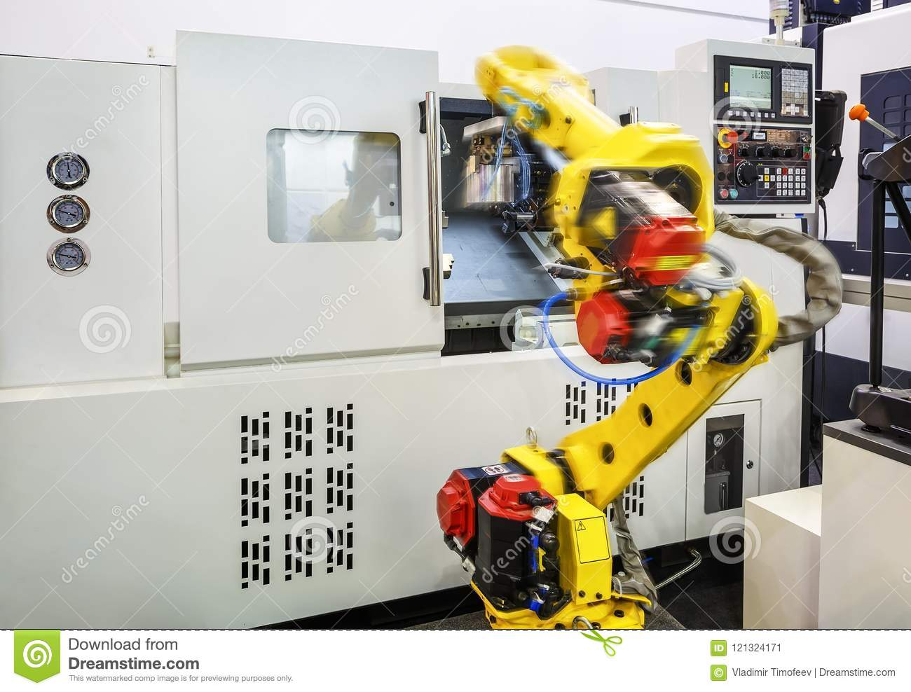 Part Of The Cnc Milling Machine With Control Panel And Robot In Motion Blur  Moves A Part From The CNC On The Conveyor Stock Image - Image of machining,  intelligence: 121324171