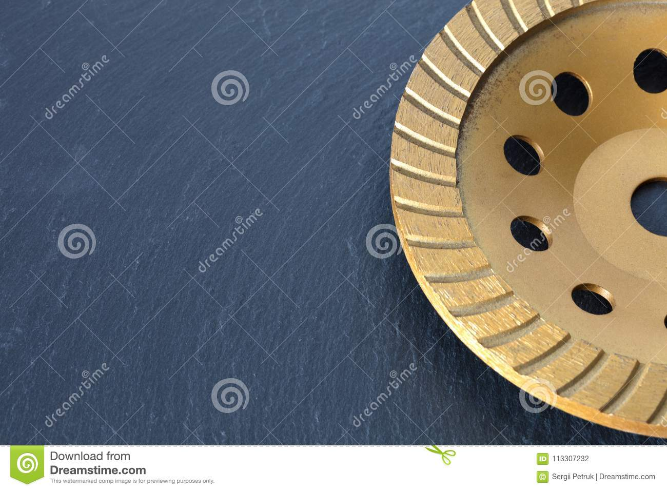 Part of the diamond grinding wheel on a gray granite background.