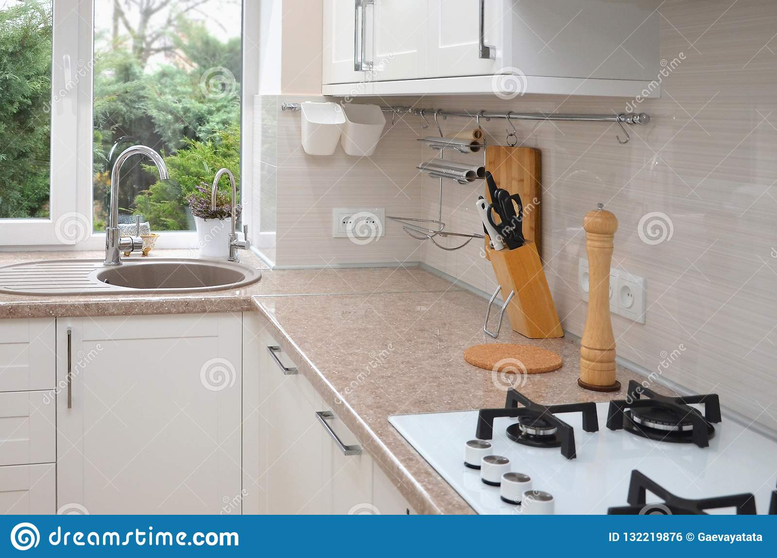 Part of the kitchen interior against the window