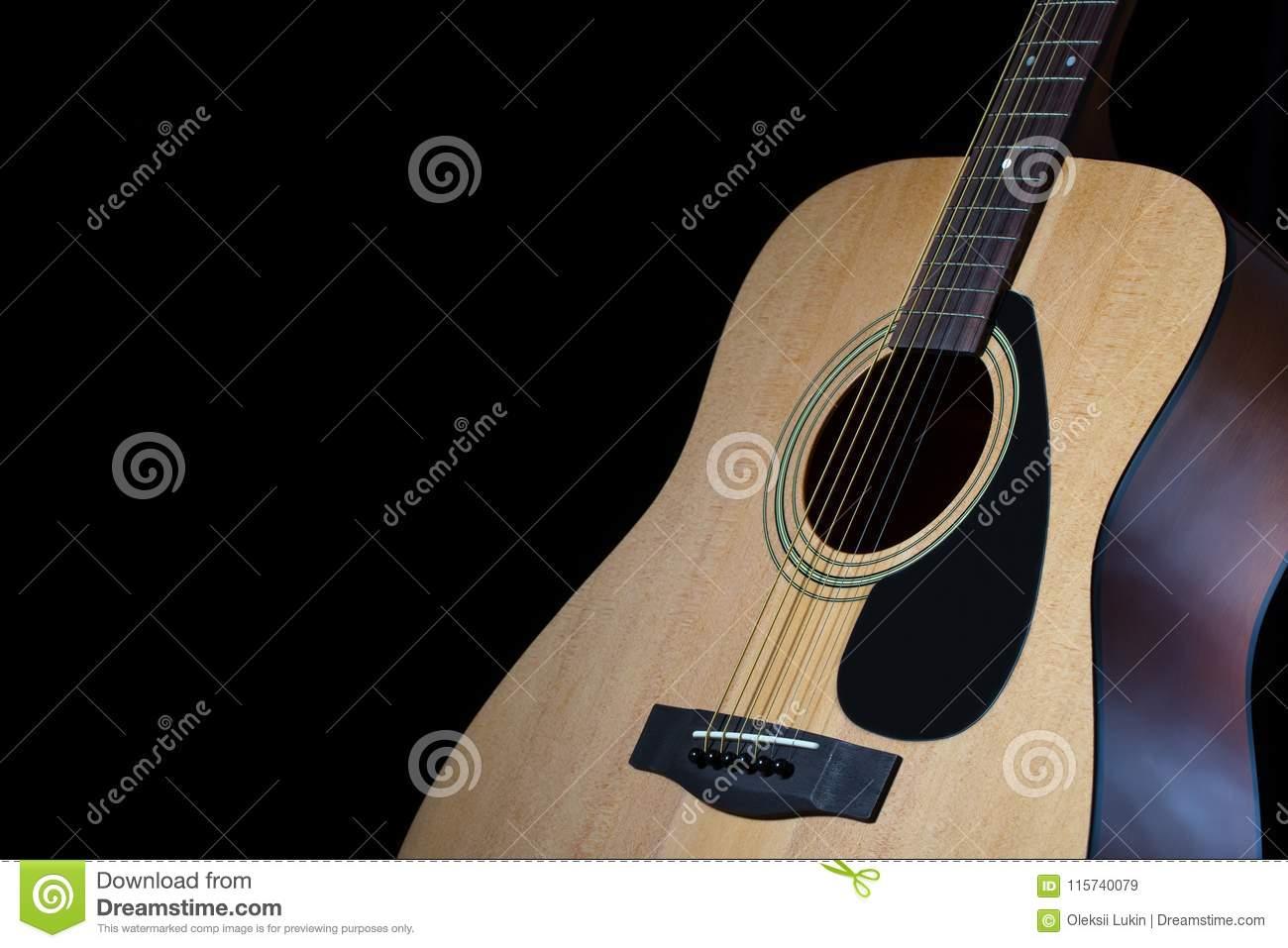 Part Of Modern Acoustic Guitar On Black Background Stock Image