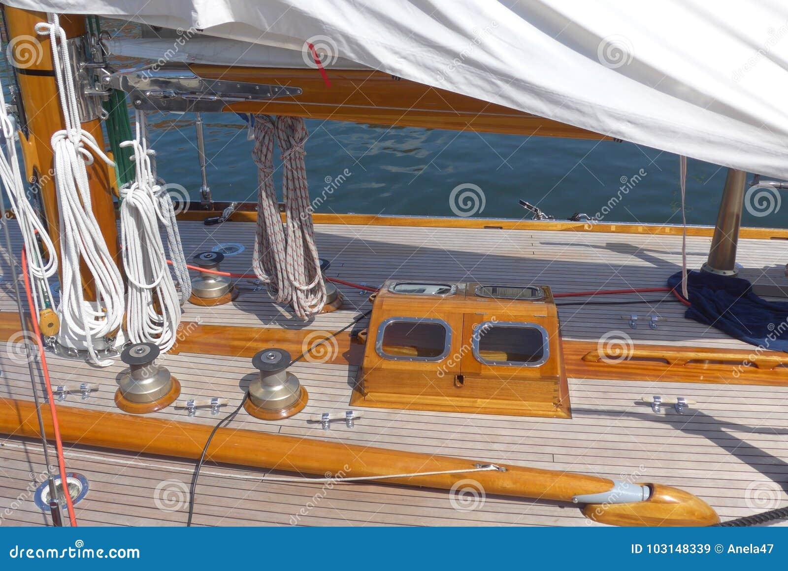 Detail photos of a sailing yacht, teak deck