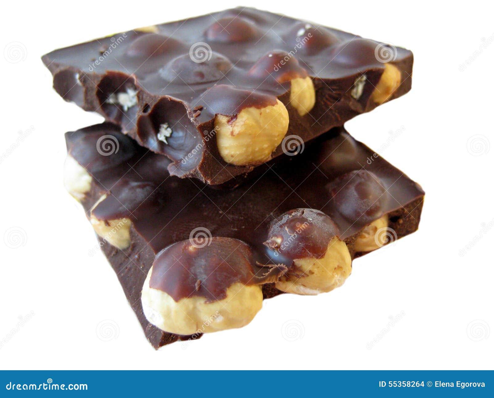 Parti del cioccolato su priorità bassa bianca