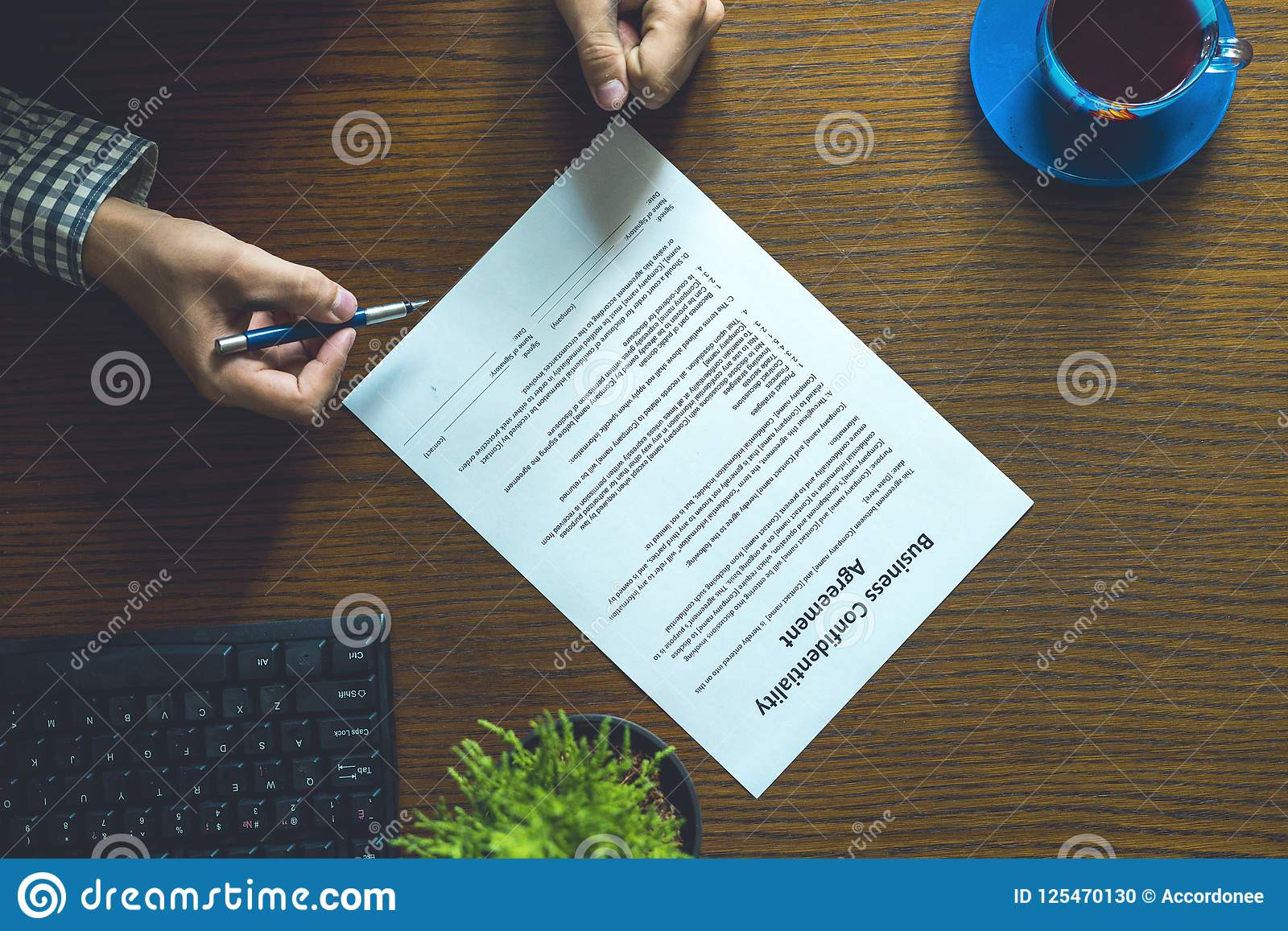 Partnership Agreement Business Document Signed By A Person On The