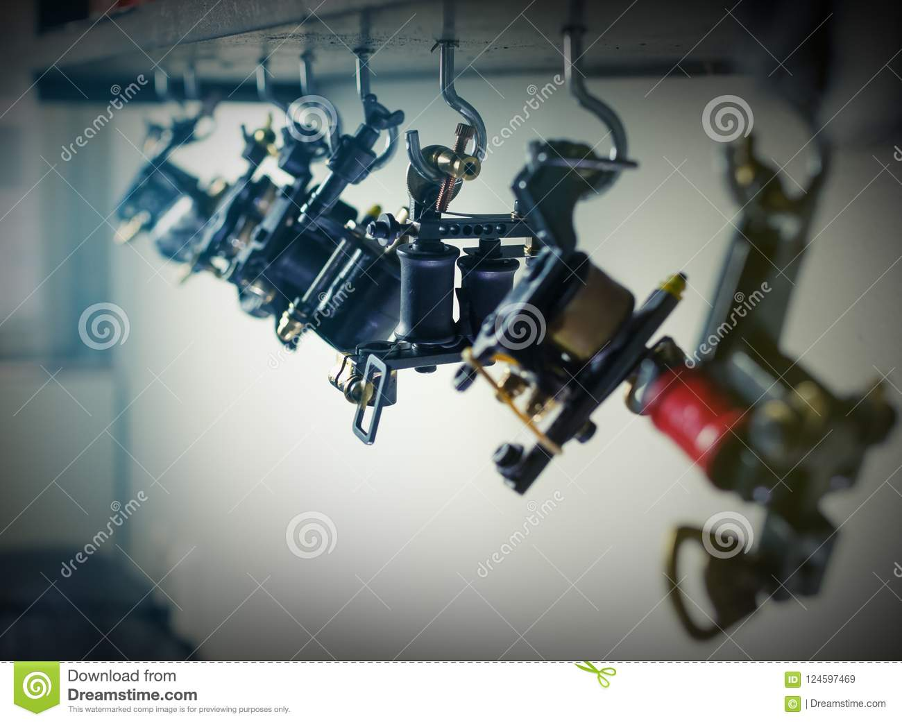 Parts Of Coil Ink Tattoo Machine, Hanging On Wooden Shelf, Clos ...