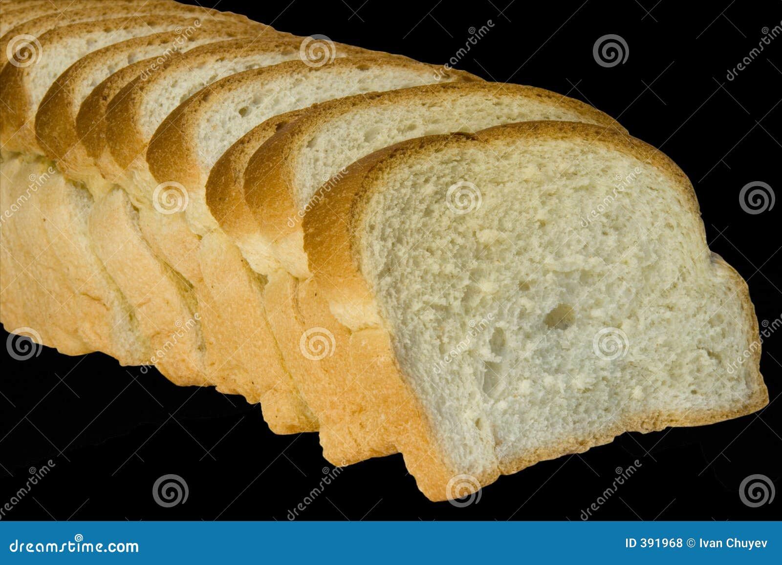 Parts de pain d isolement sur le noir