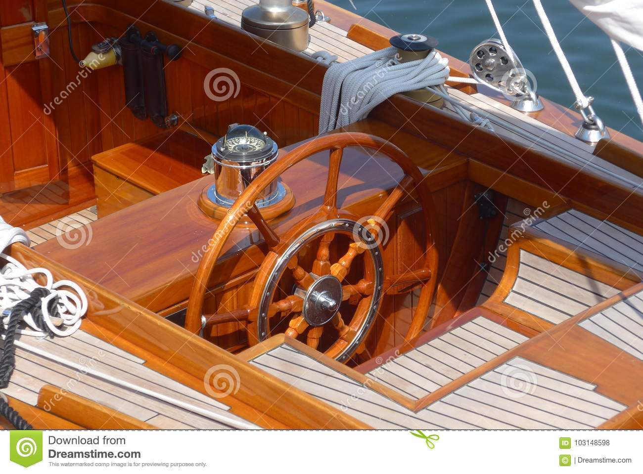 Detail photos of a sailing yacht, steering wheel, teak deck and compass