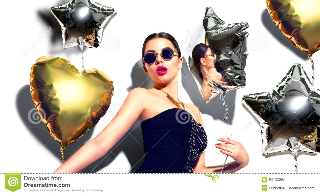 Party. Beauty model girl with colorful heart and star shaped balloons