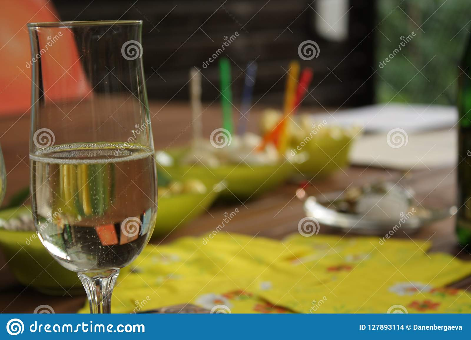 Glass with sparkling drink in the party time