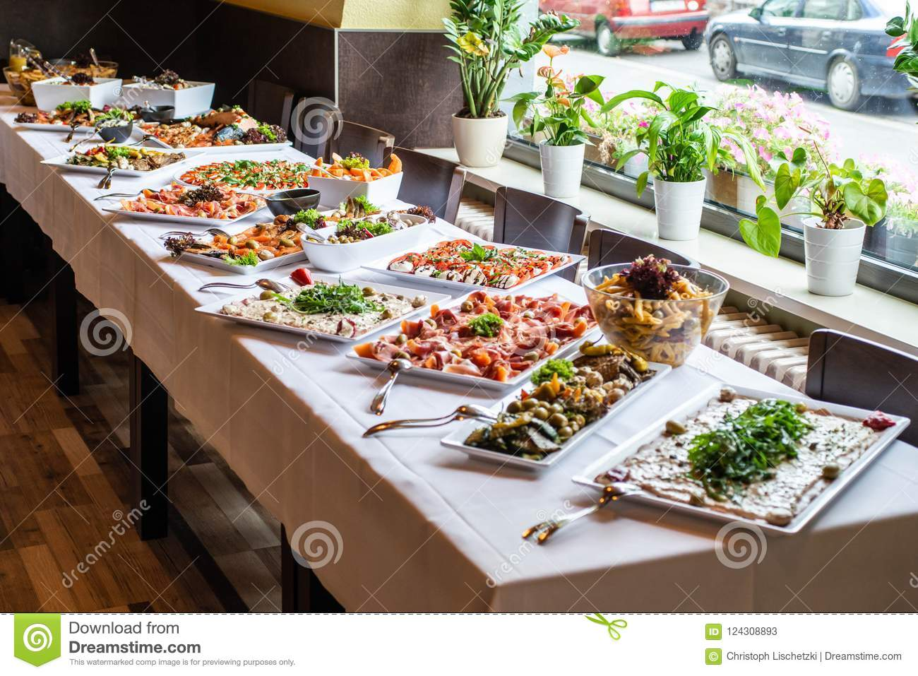 party brunch big buffet table setting with food meat vegetables