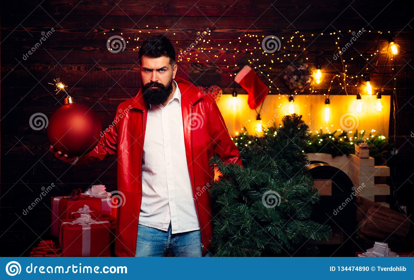 Party Christmas. Christmas man in fashion red dress hold bomb. Christmas sale. Sparkle blast. Christmas party. Happy