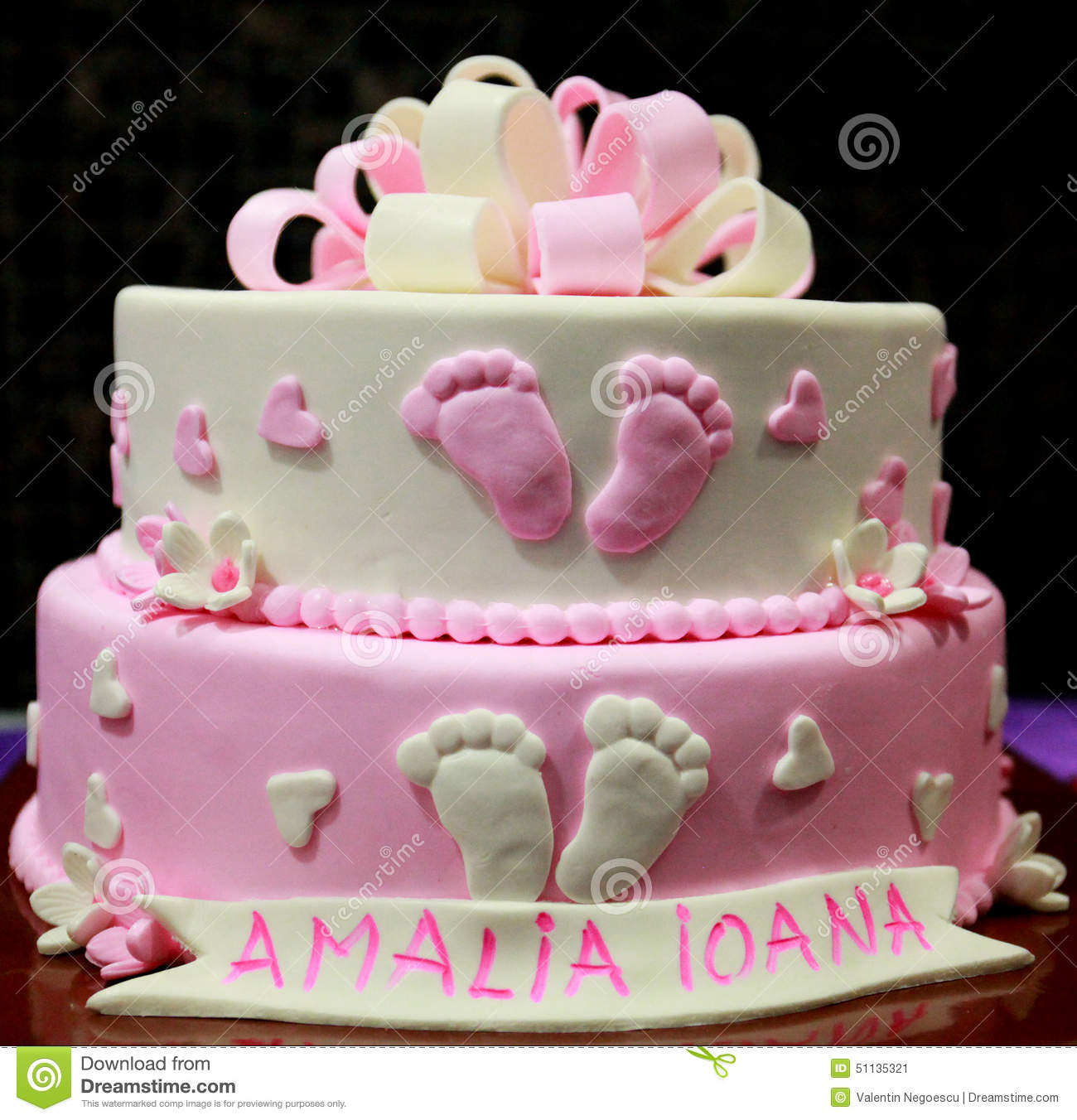Stock Photo: Party pink newborn cake with name, a lovely idea birthday ...