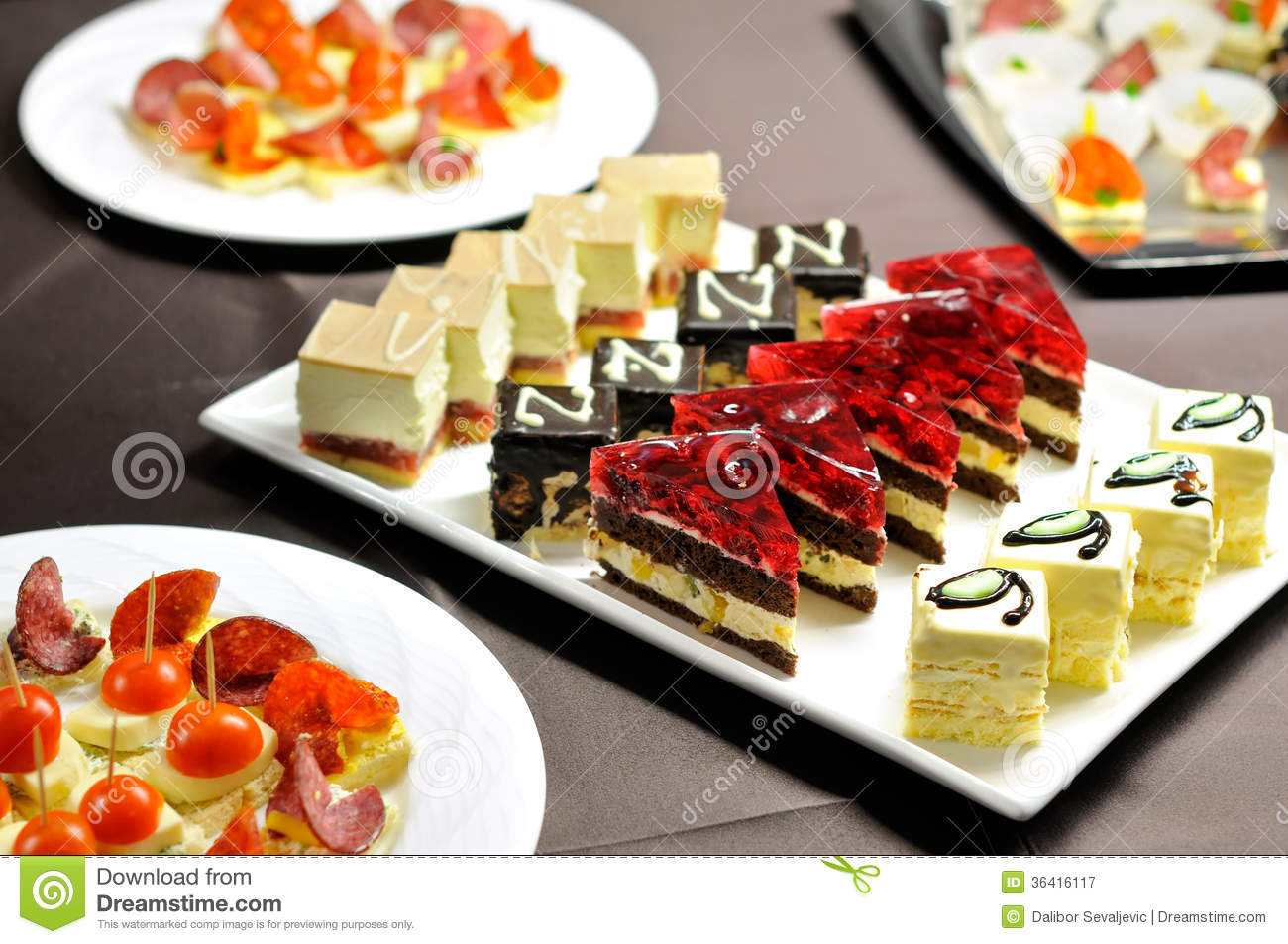 Party table with cakes and canapes royalty free stock for Canape menu prices