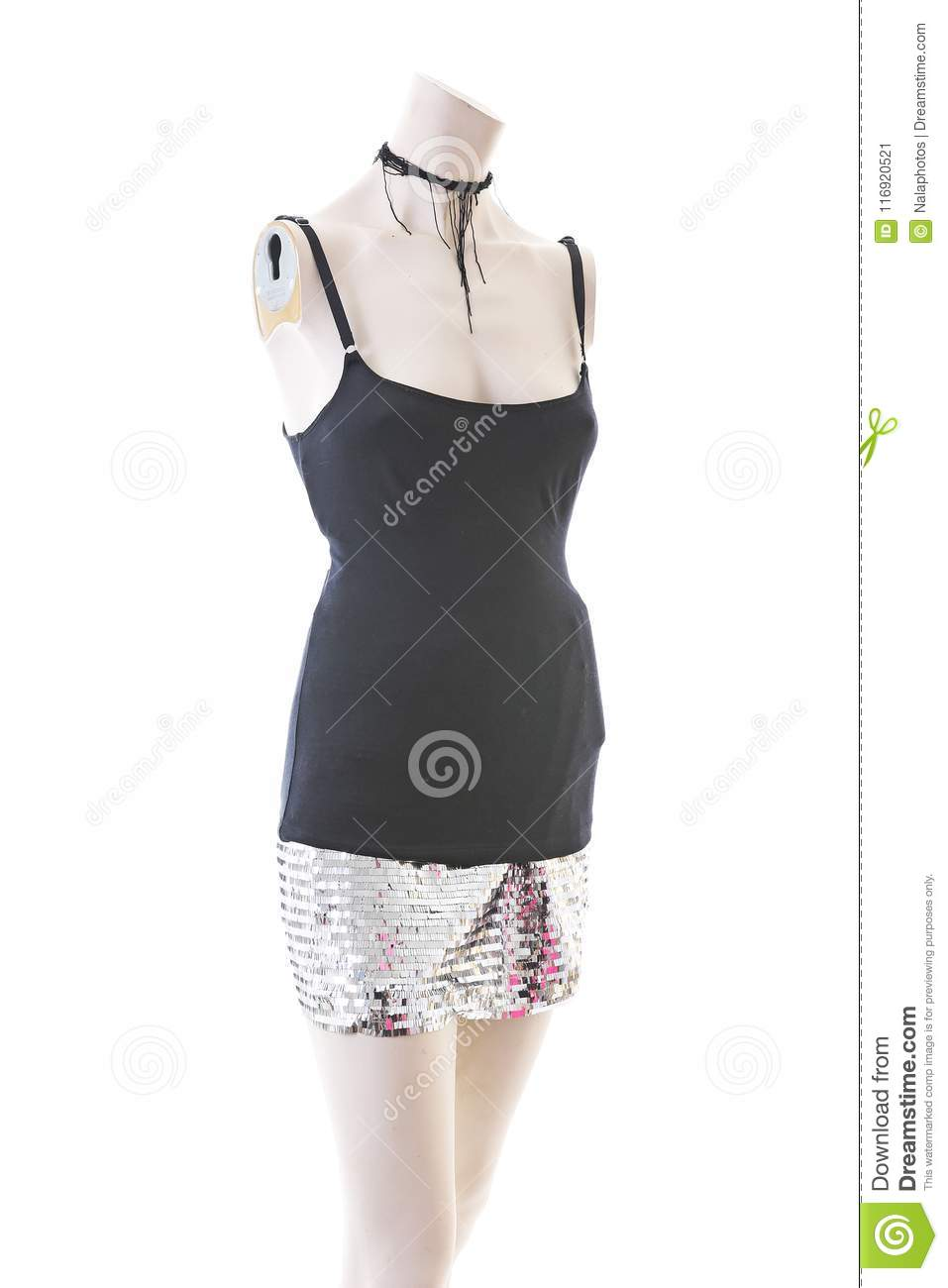 Party top black and silver with mini mirror skirt on mannequin full body shop display. Woman fashion styles, clothes on