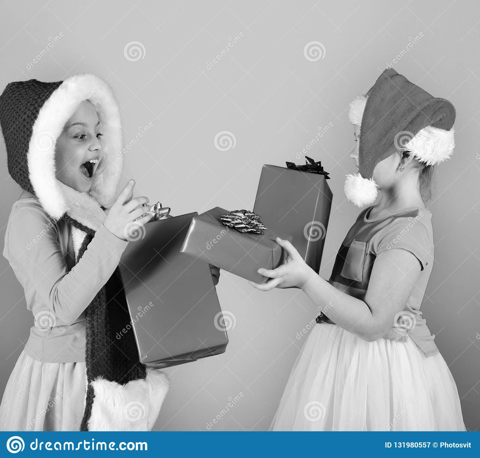 Partying and holiday concept. Children with surprised faces