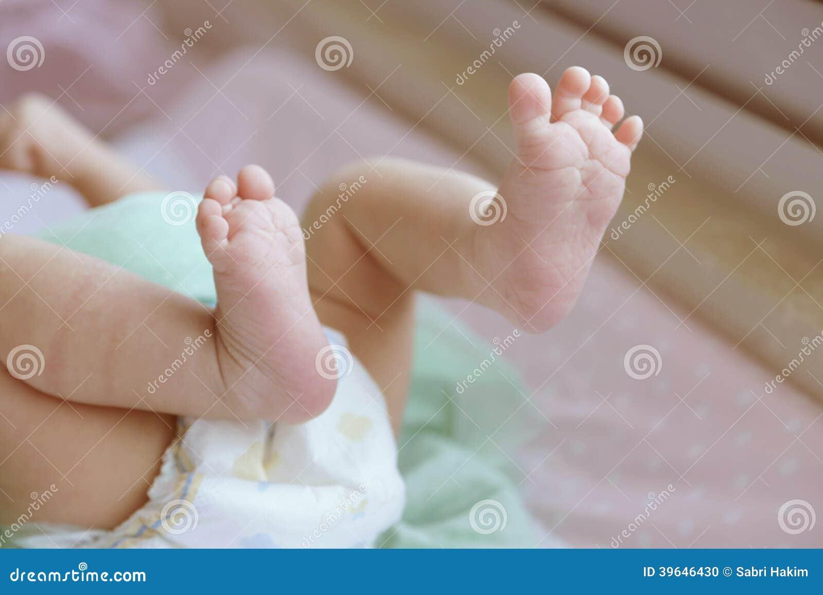 Pasgeboren Babyvoeten en Tenen