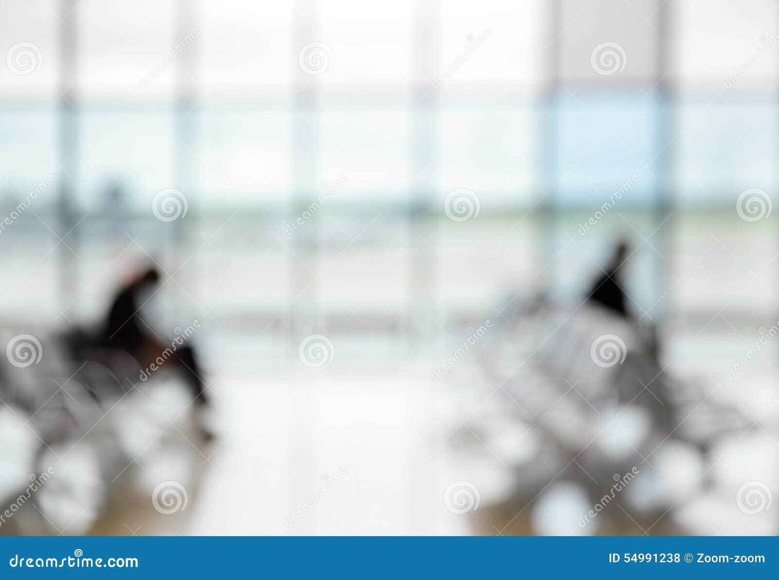 Passagerare i flygplatsvardagsrummet